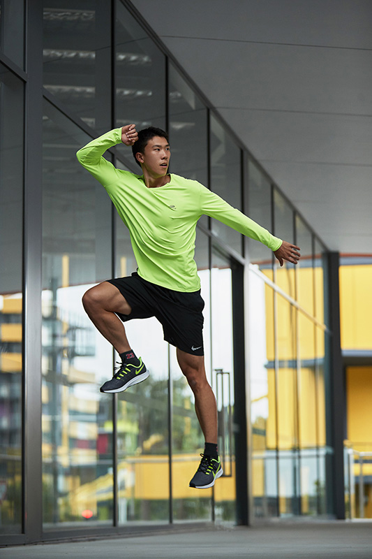 Andrew Brisbane_s fitness model jumping in yellow nike shirt
