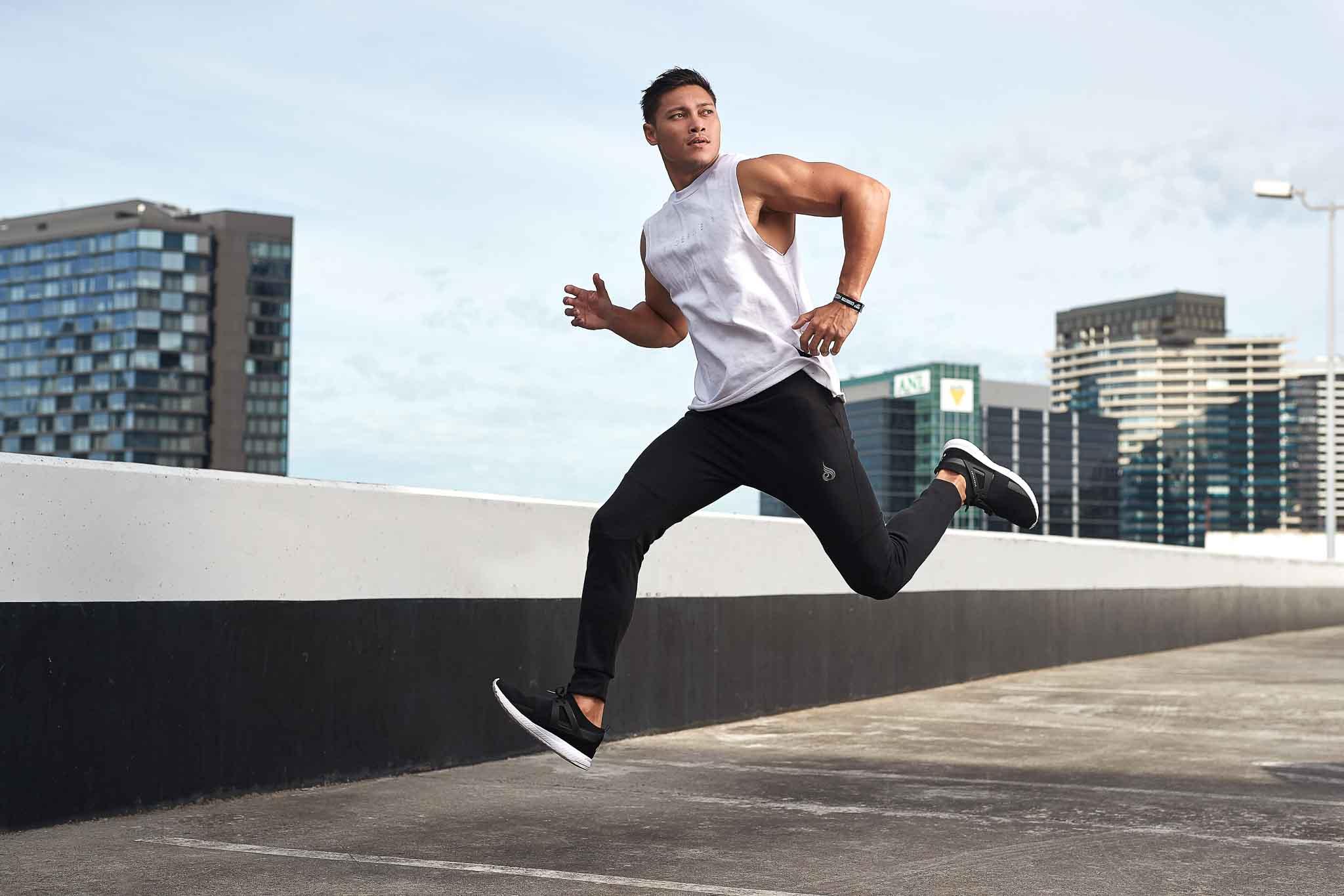 Andrew Mc Darwins leading male fitness model running through car park