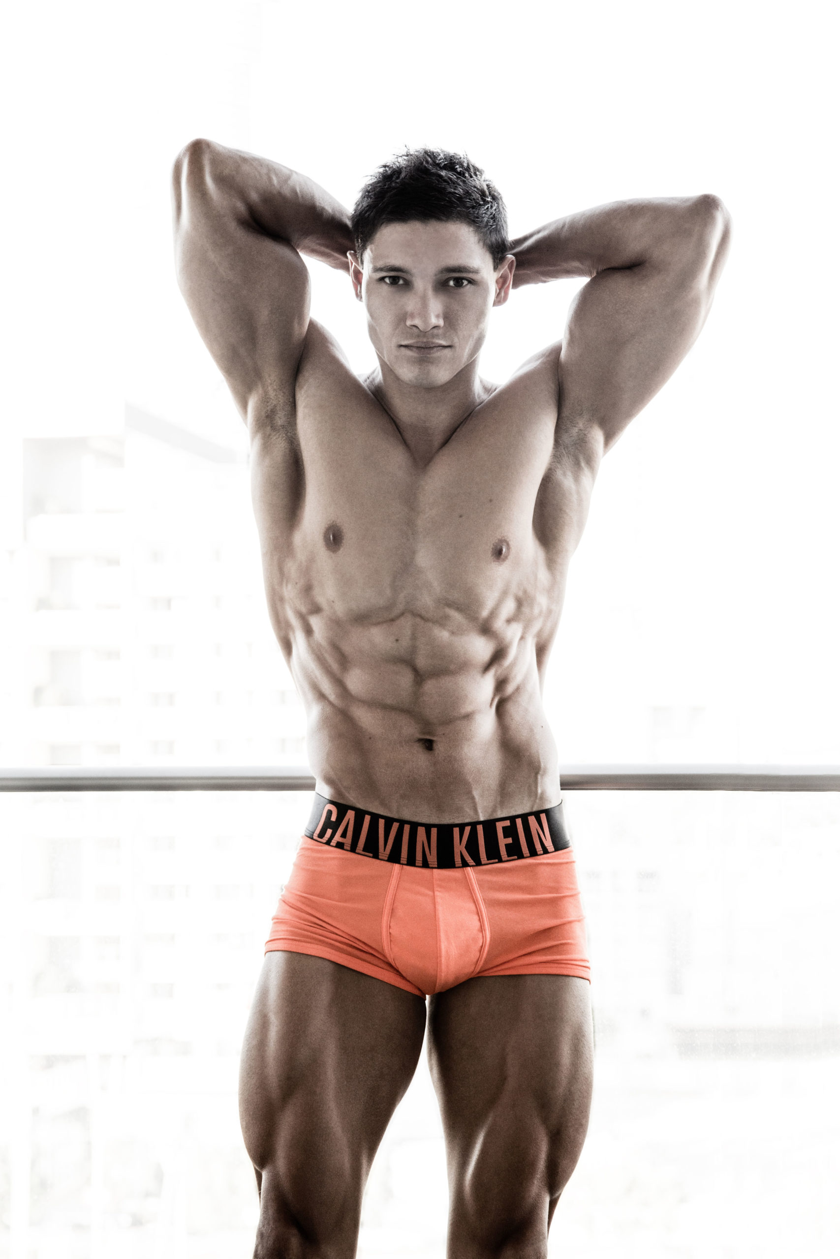 Andrew Mc flexing doing a most muscular abdominal pose