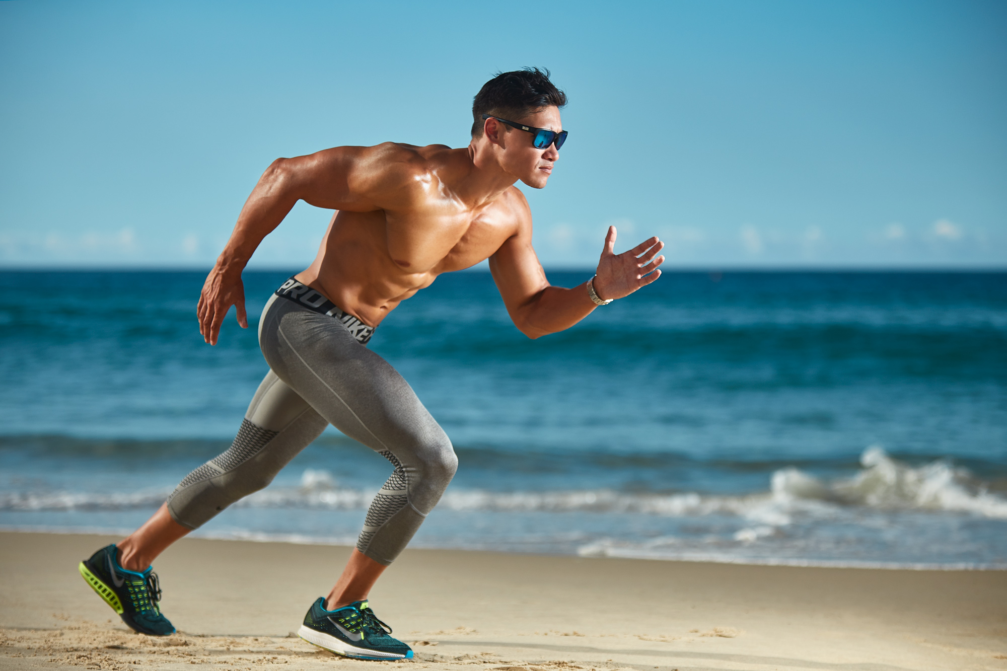 Andrew Mc running in Nike pro compression pants along Queensland beach