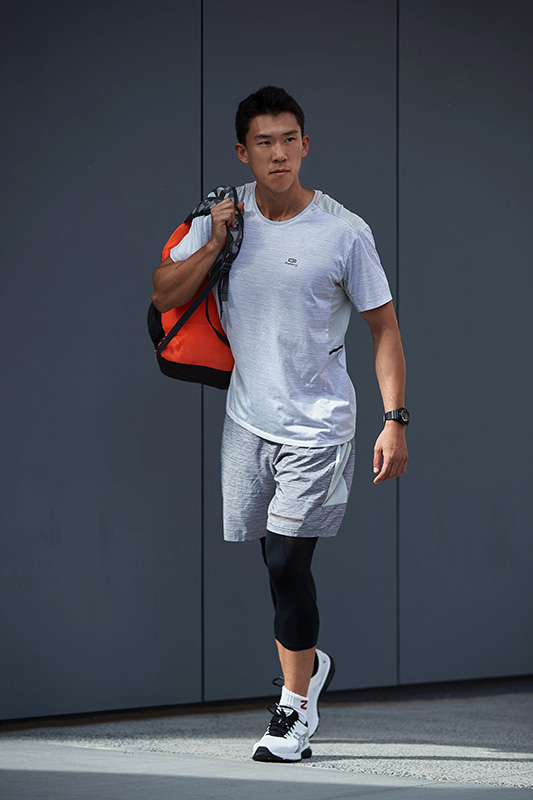 Andrew Queensland asian fitness model walking with sports bag wearing underarmour garments