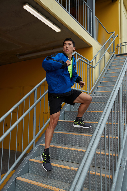 Andrew side lunging up flight of stairs wearing sports garments