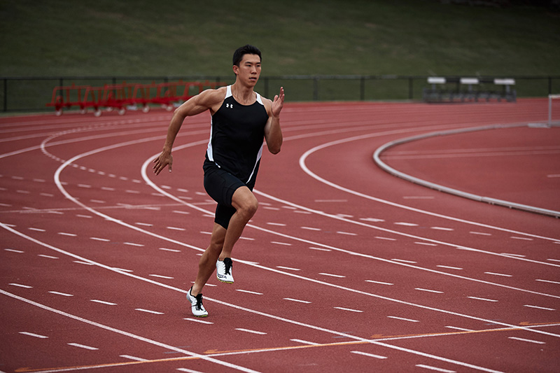 Andrew sprinting on red athletics track