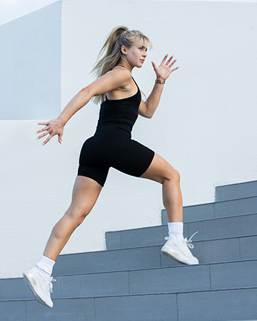 Anika Australias elite fitness model sprinting up steps