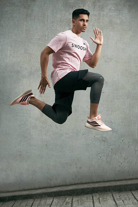 Ben P jumping high wearing pink swoosh T-shirt and loose training shorts