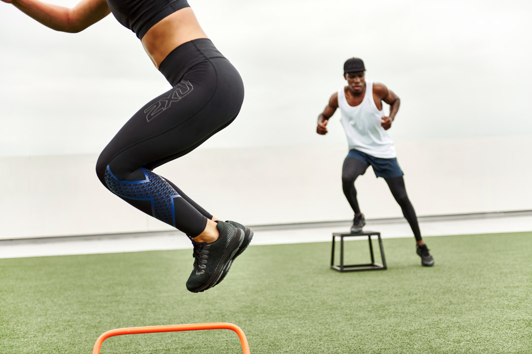Bibby jumping over a 32 cm plyometric box during 2XU fitness campaign