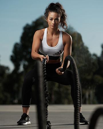 Brenice showcasing her battle ropes skills during intense fitness photo shoot