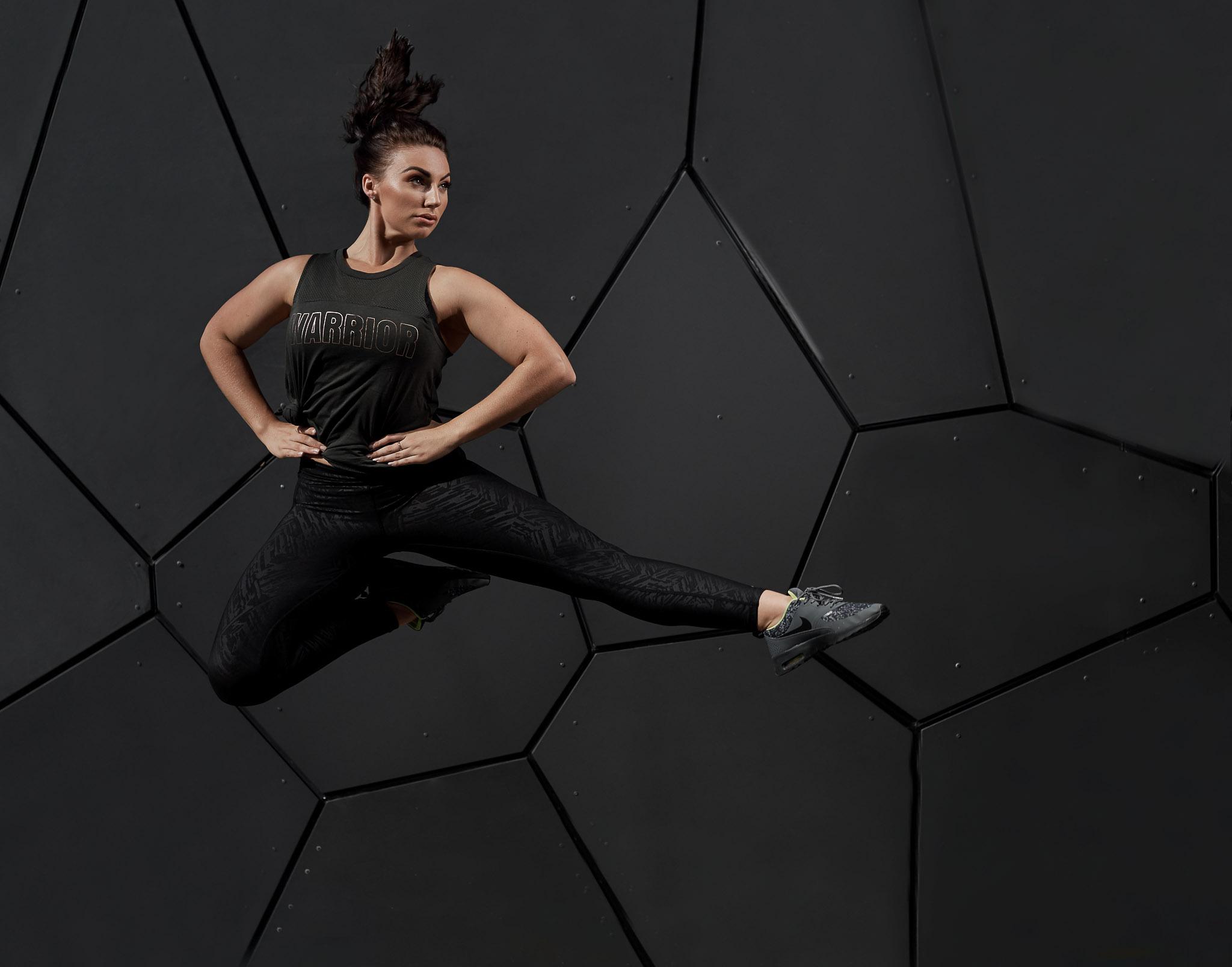 Brihannan jumping in black training gear