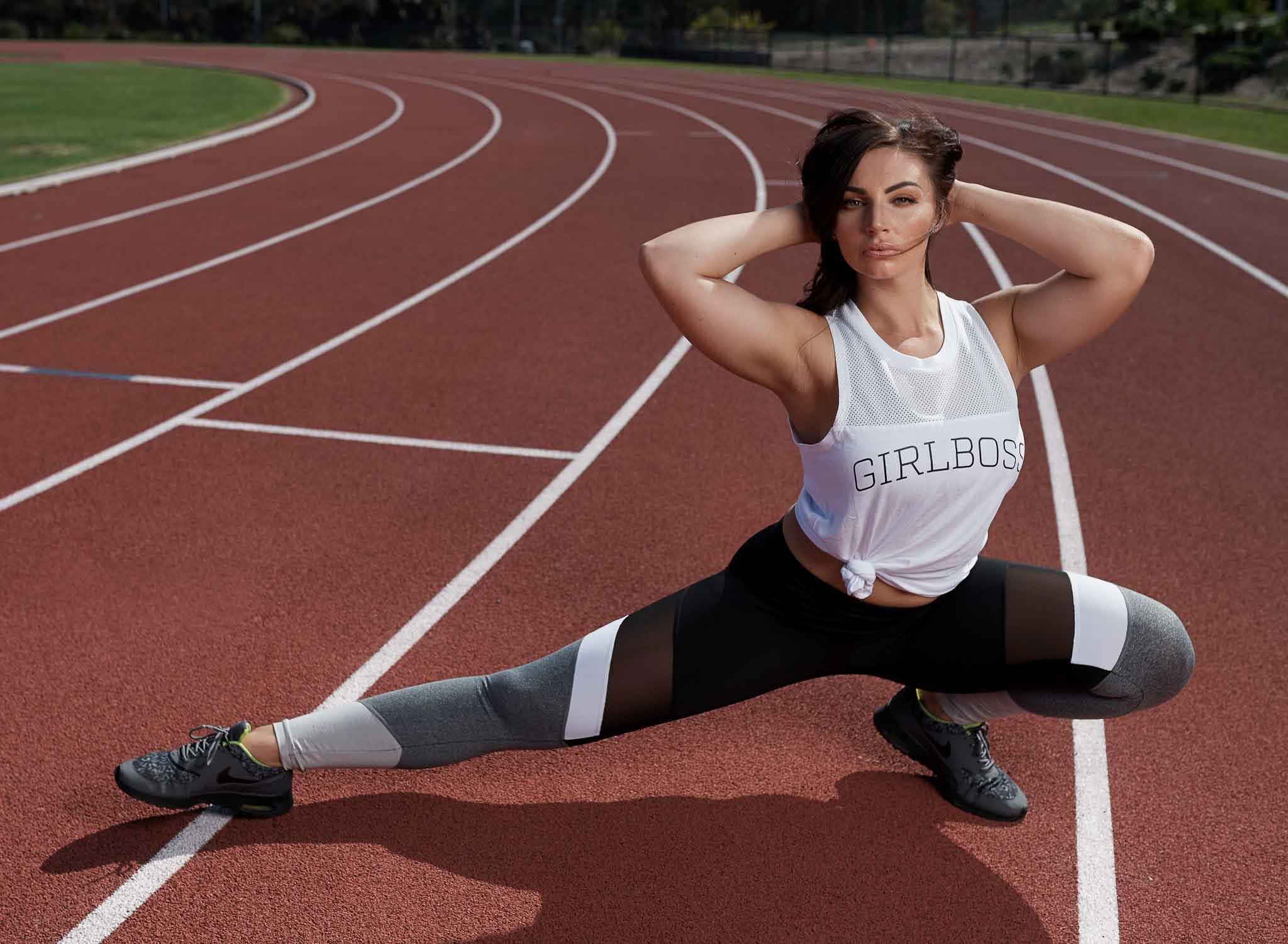 Brihannan stretching on running track