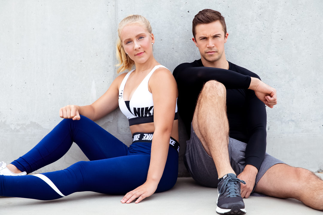 Caitlin and Neal seated together during their fitness for the shoot