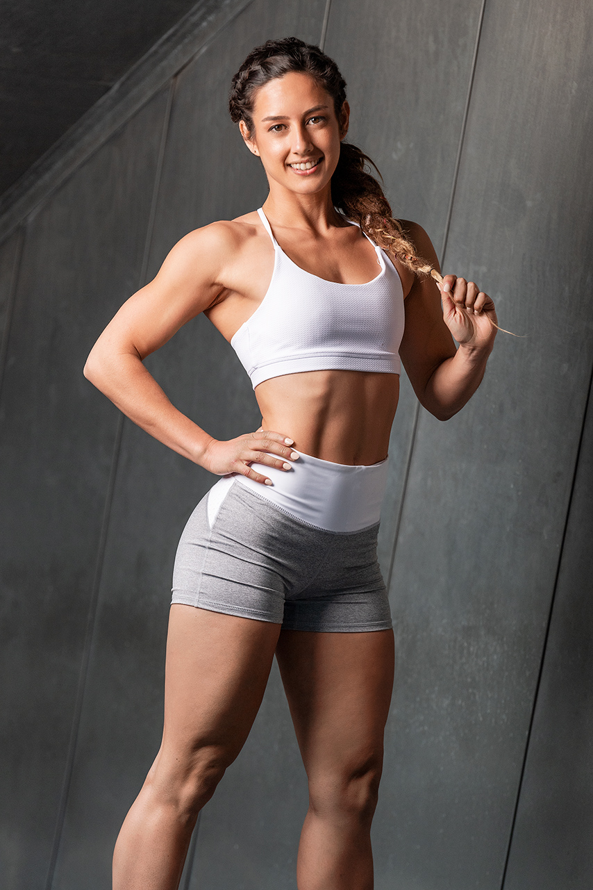 Cassandra wearing grey sport shorts and crop top during her Melbourne fitness portfolio shoot