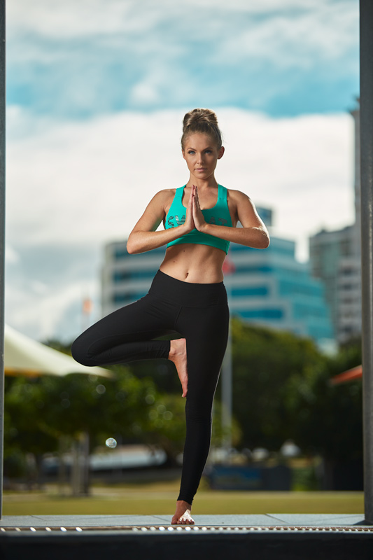Centelle performing standing yoga pose at Griffith University