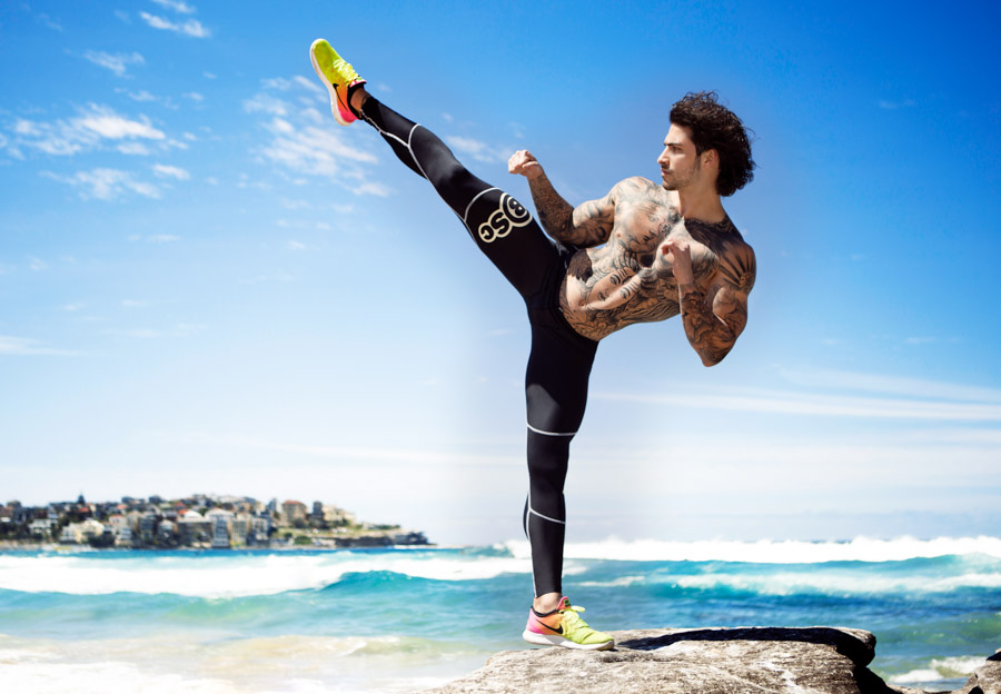 Christian performing an overhead kick at Bondi Beach