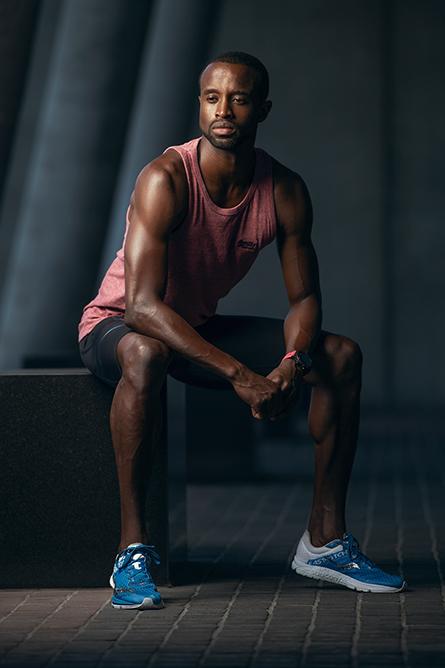Darren L Sydney mail fitness model sitting on concrete stump