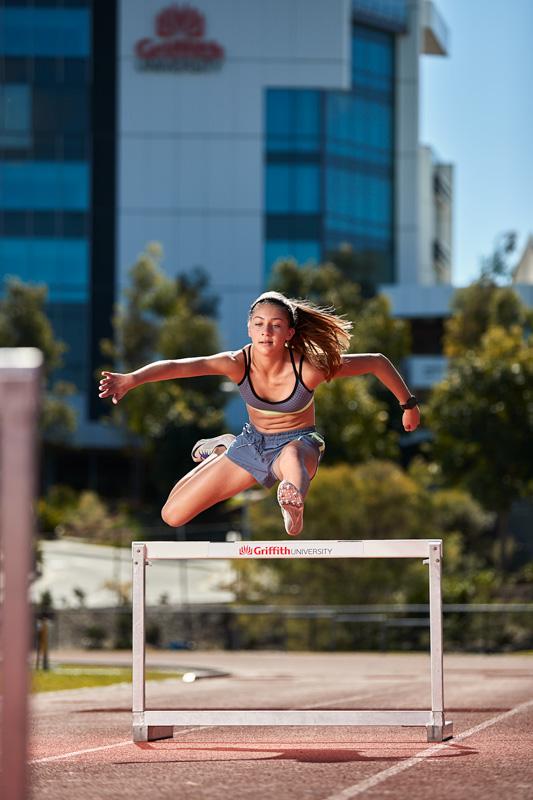 Ella Queensland teen fitness model jumping over hurdles