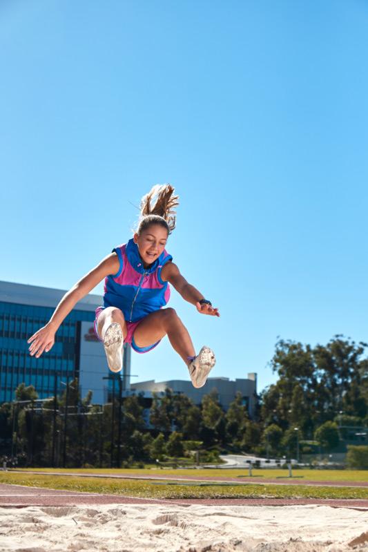 Ella performing the long jump