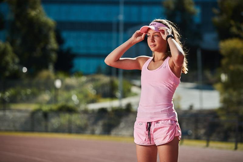 Ella wearing Lorna Jane matching pink shorts and top