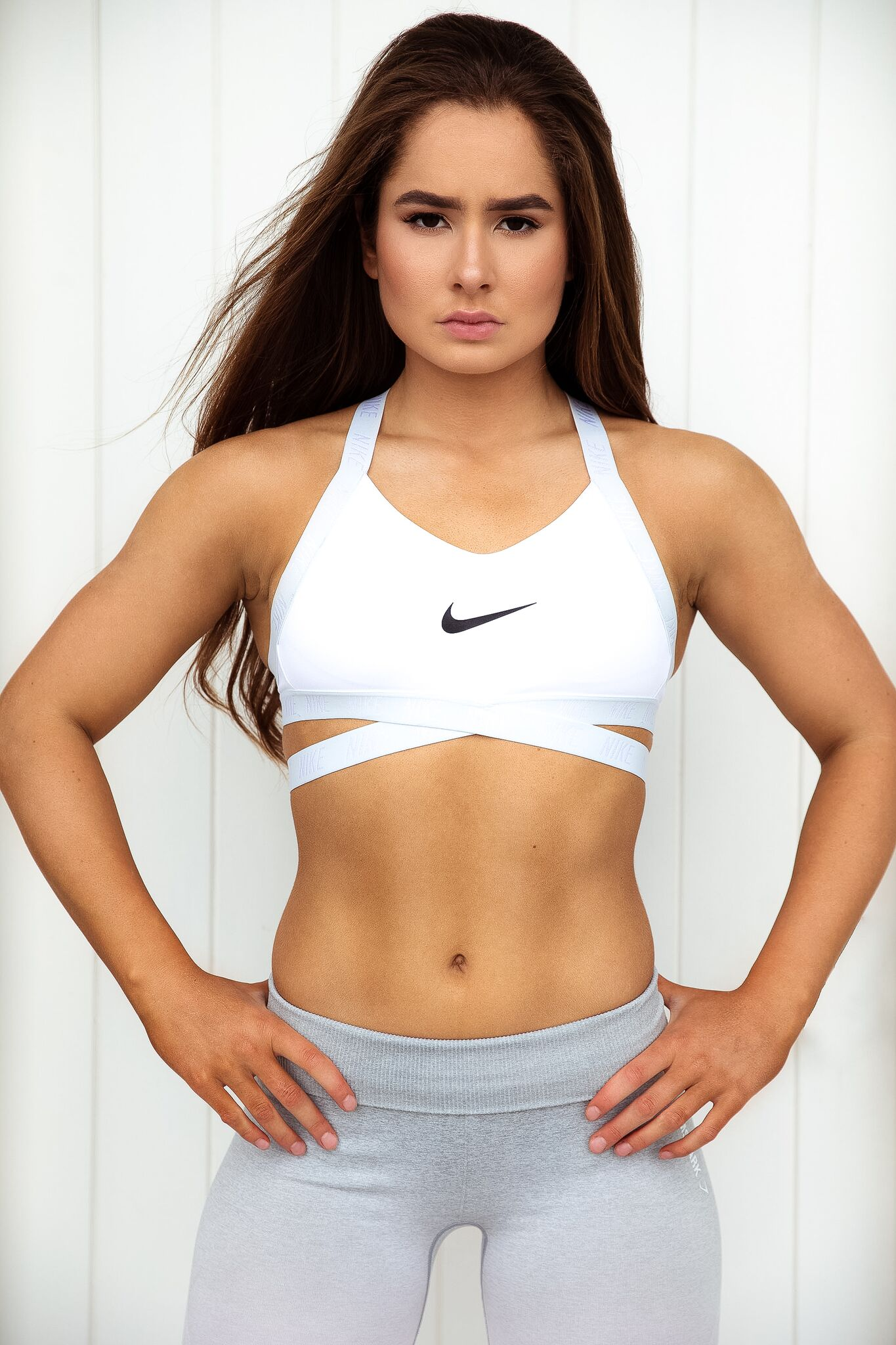 Emily V posing strong in her Nike crop top