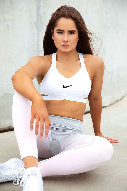 Emily V seated in her recent portfolio shoot wearing her latest Nike garments