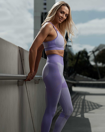 Emma V leaning against metal railing at Melbourne's AAMI Centre