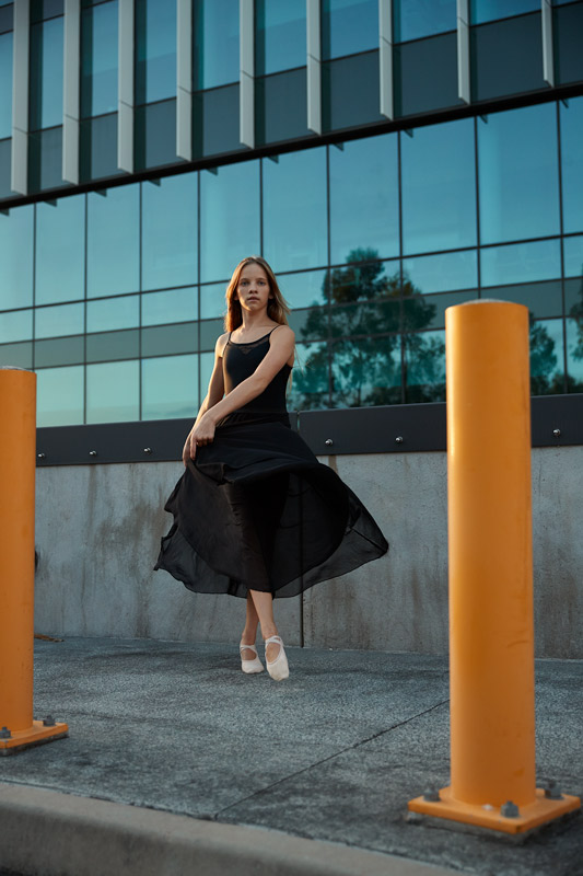 Gege wearing black flowing dress