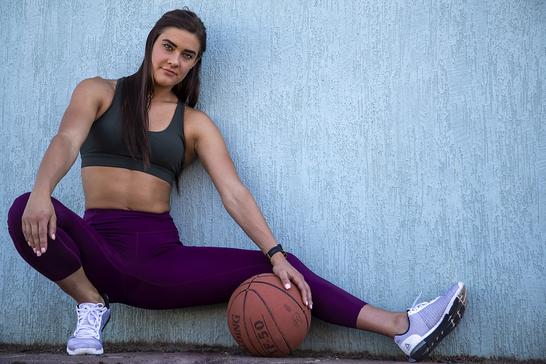 Georgia B Melbourne's young female fitness model crouching holding basketball