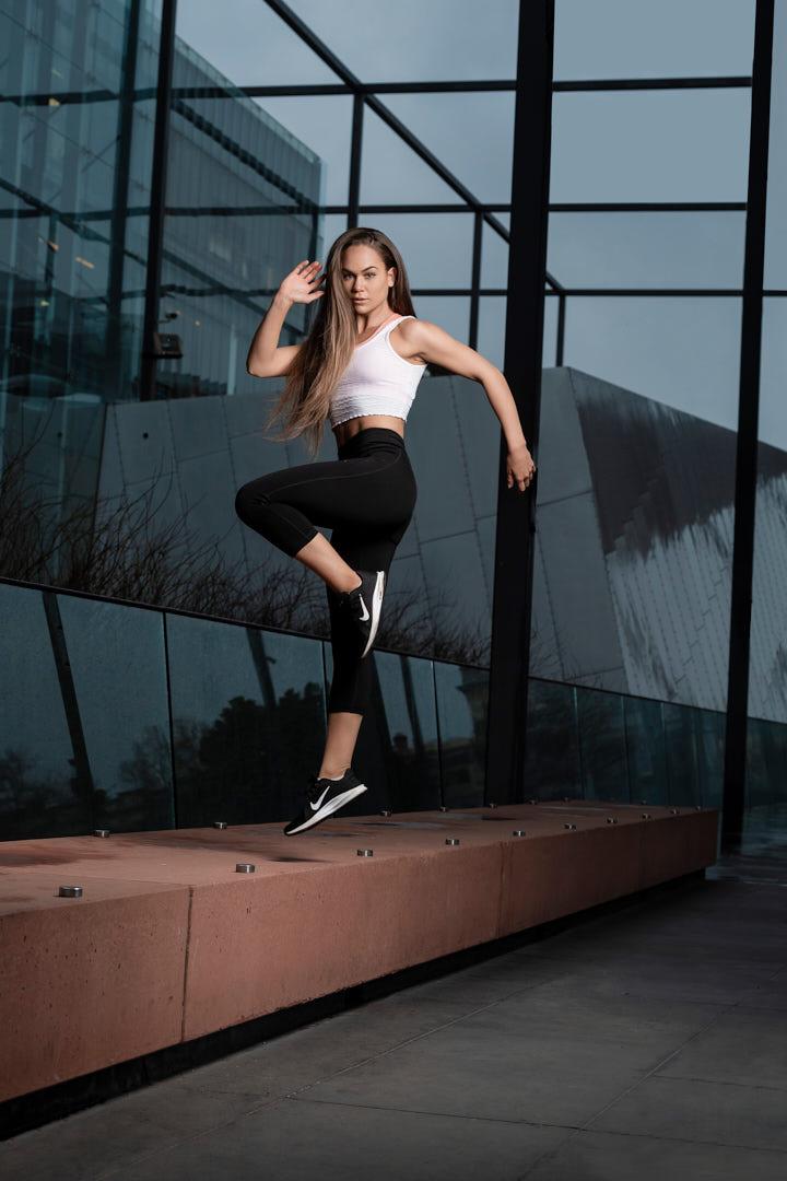 Georgia R stepping dynamically onto a platform at Melbourne Museum