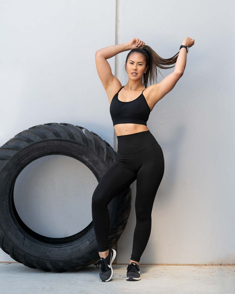 Gladysha melbounes fitness model standing next to a heavy tyre