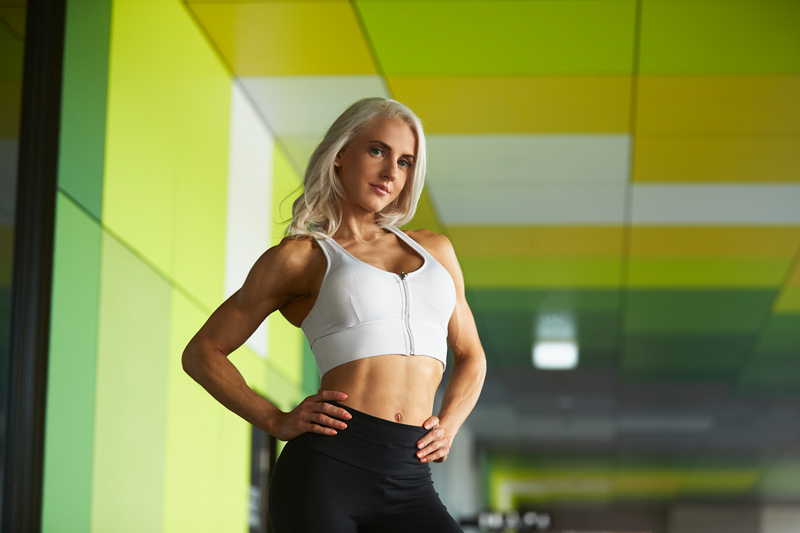 Jacquie female fitness model posing at Griffith University during her fitness portfolio shoot