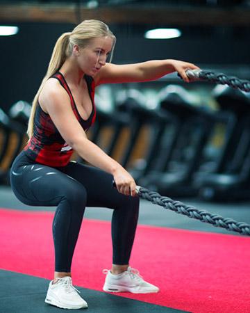 Jaimye training on the battle ropes