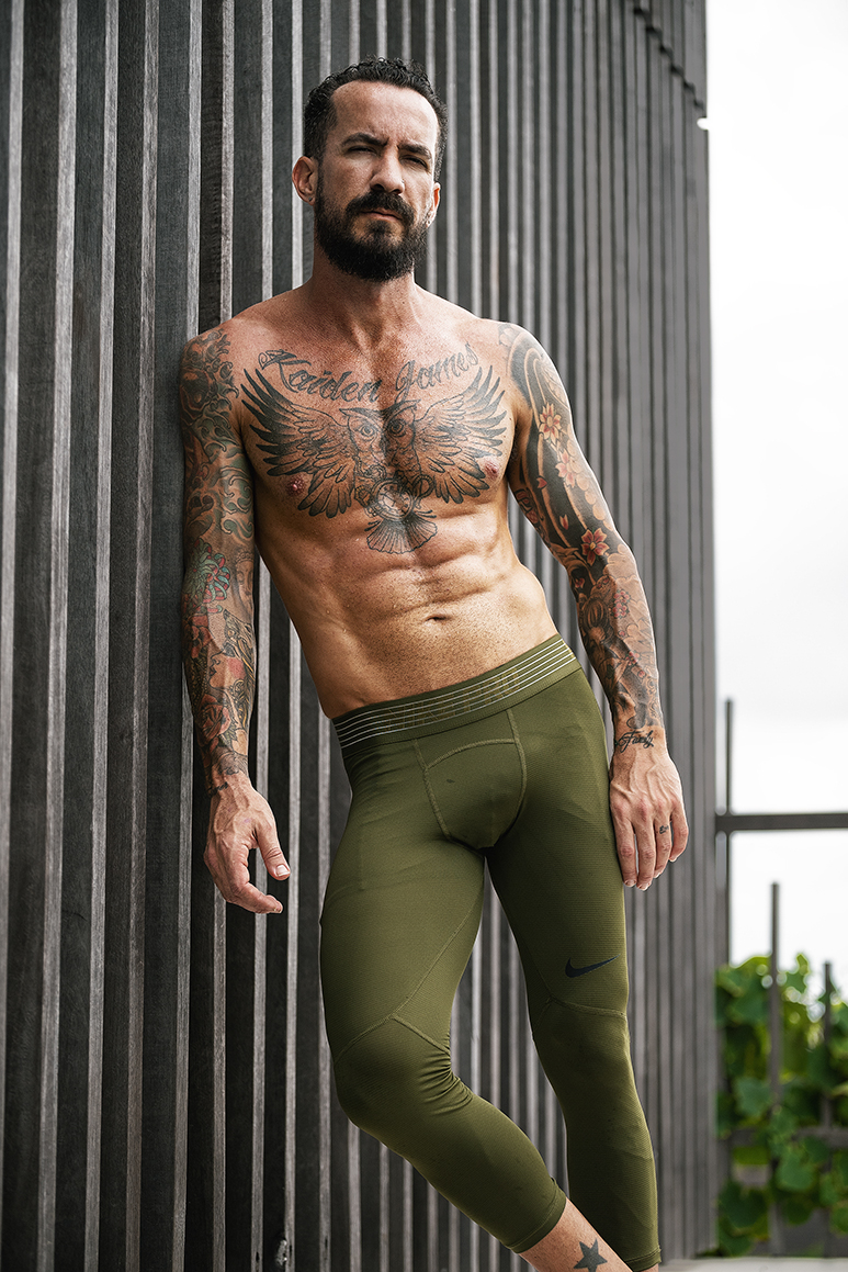 James Sydneys male fitness model wearing green compression wear