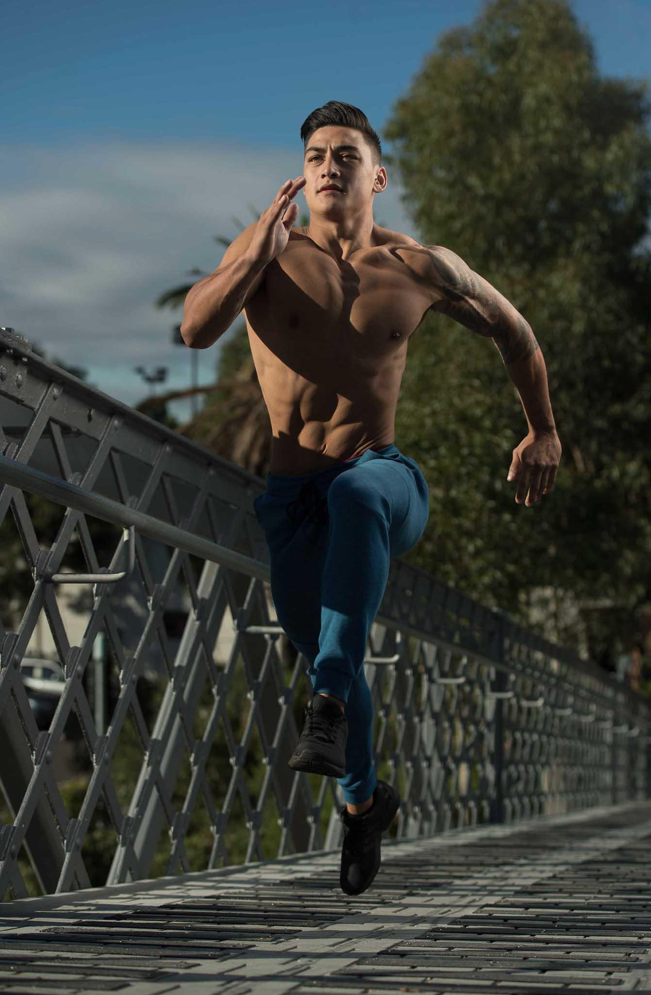 James sprinting Over a bridge walkway