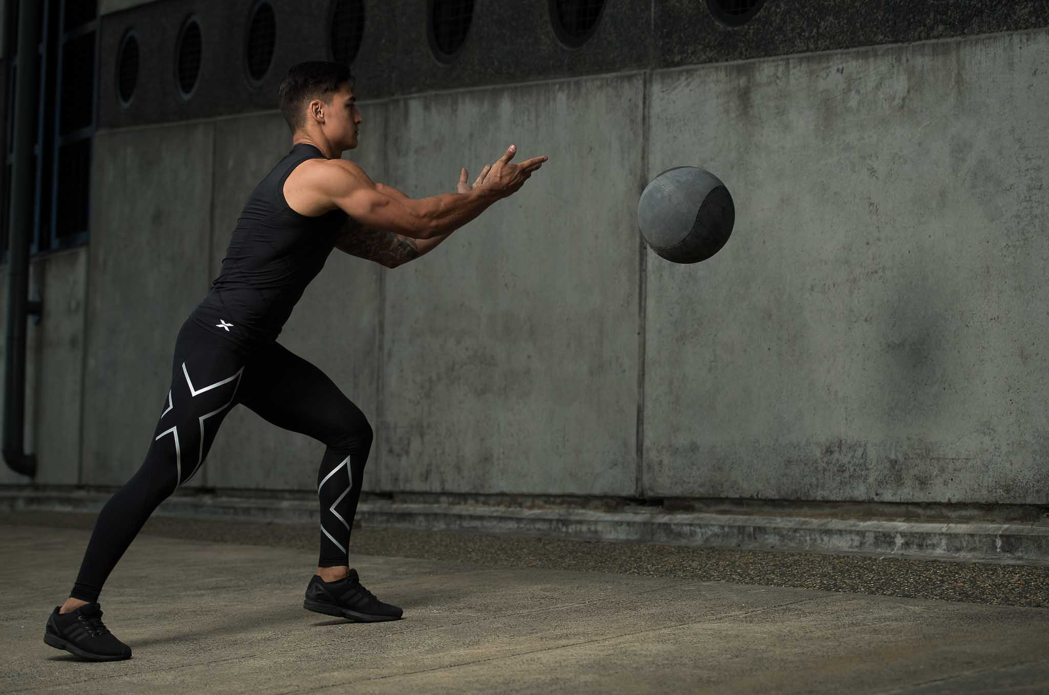 James throwing a medicine ball against the wall