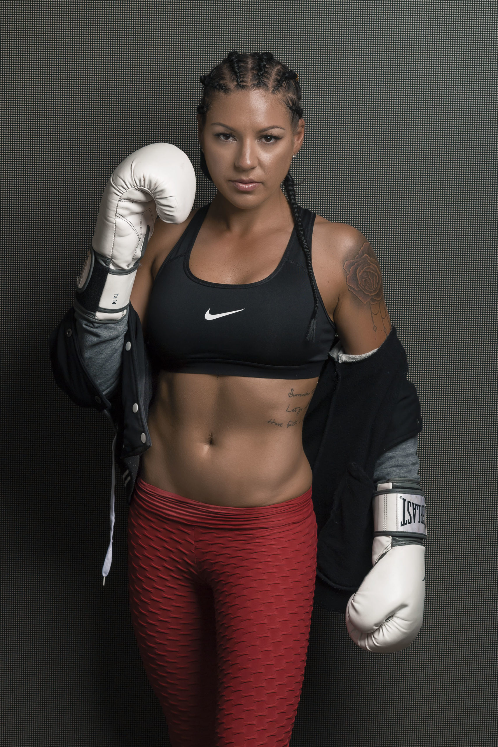Janey Queensland female fitness model wearing Everlast boxing gloves and Nike branded outfit