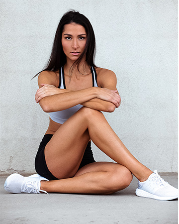 Jes B sittng during fitness photo shoot