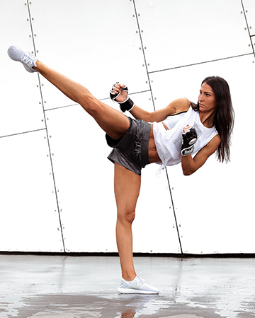 Jess B performing a roundhouse kick
