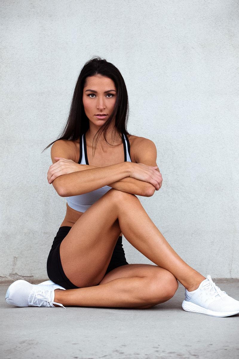Jess B sitting cross legged