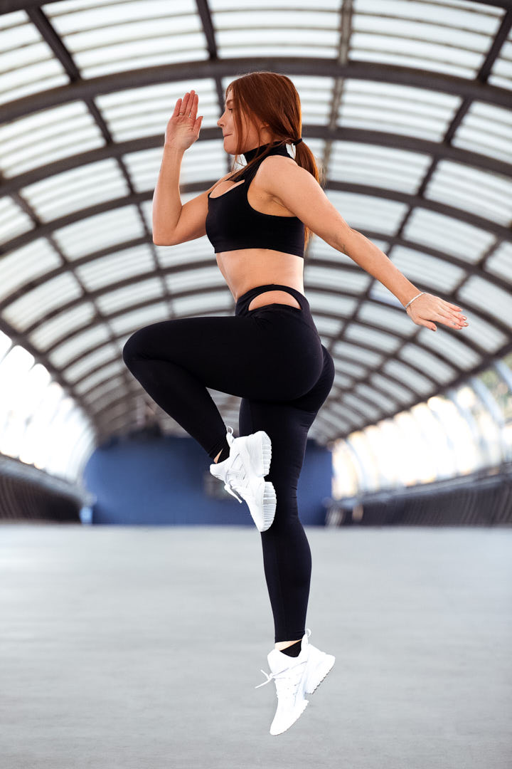 Jessica female fitness model jumping