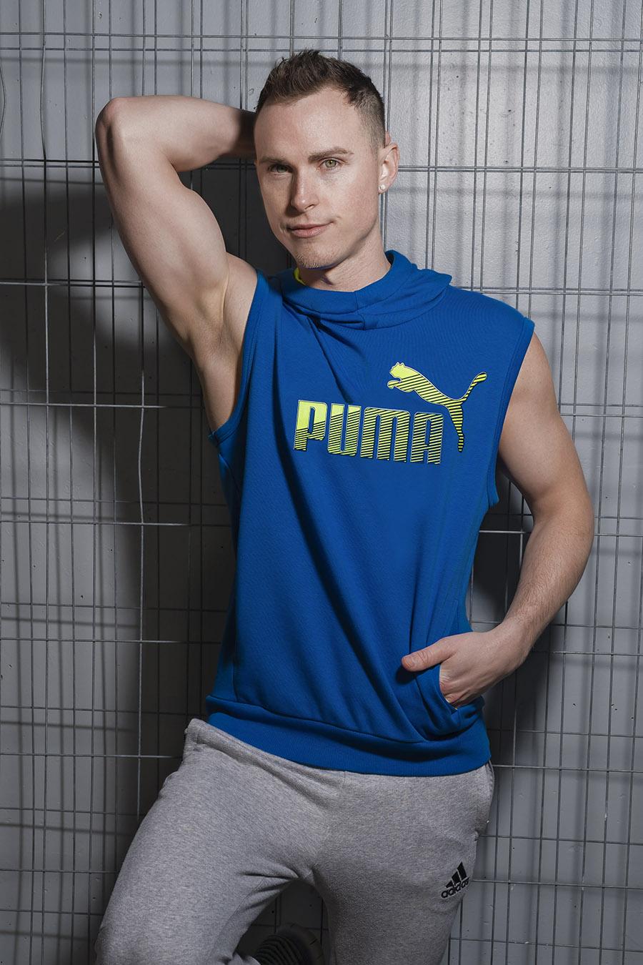 Jordan male fitness model wearing puma garments