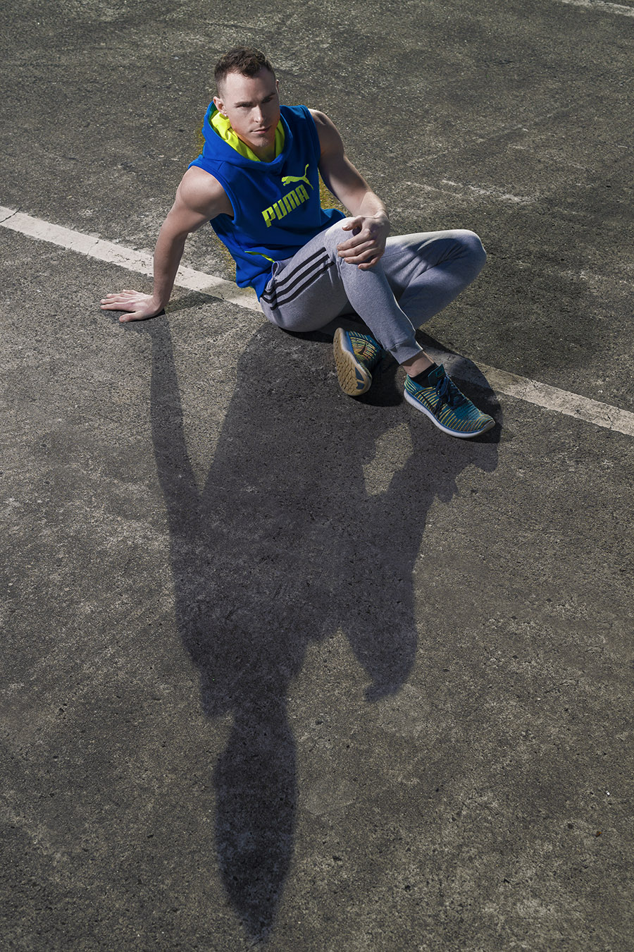 Jordan seated on ground in Melbourne car park