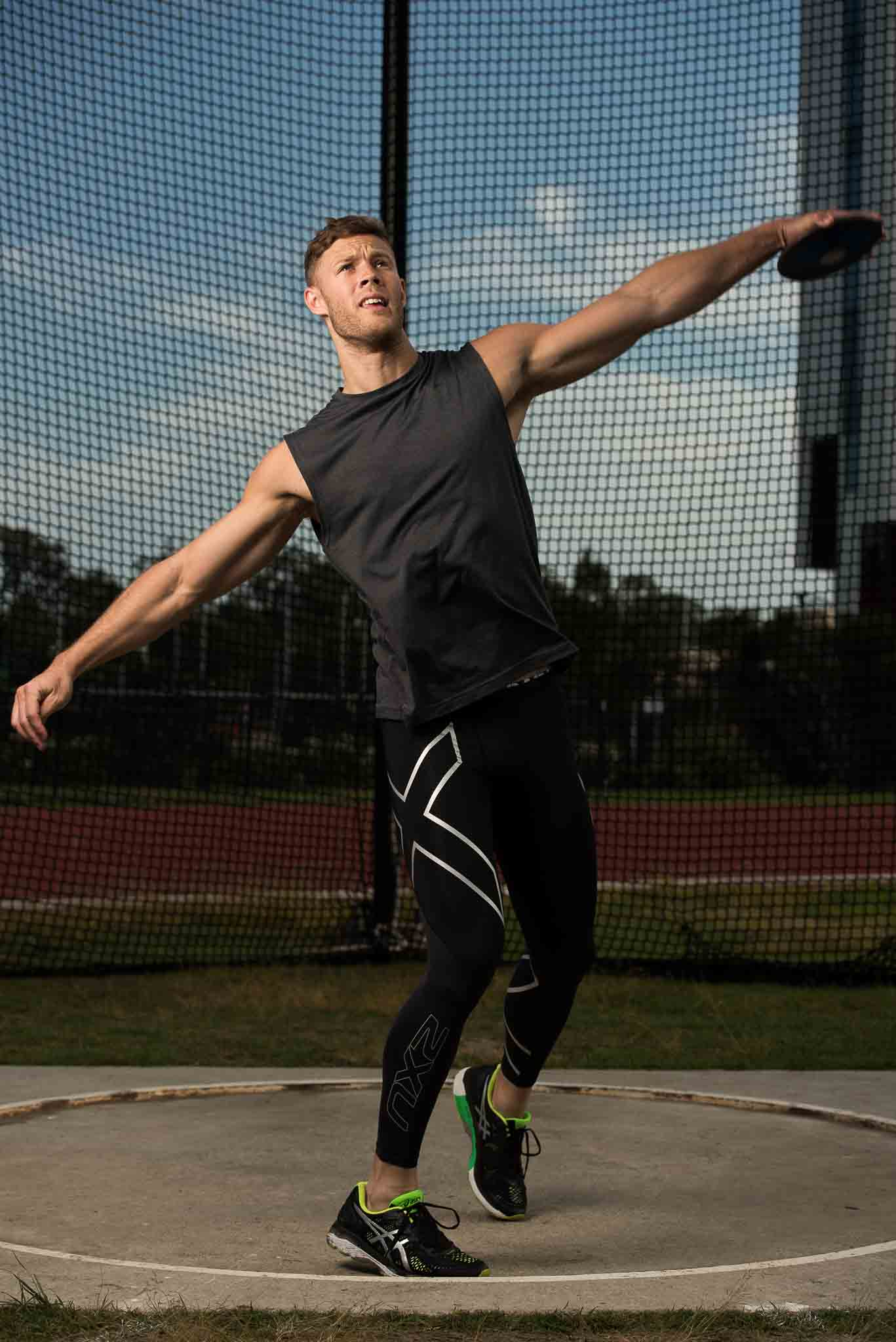 Josh Brisbane's fitness model throwing discus
