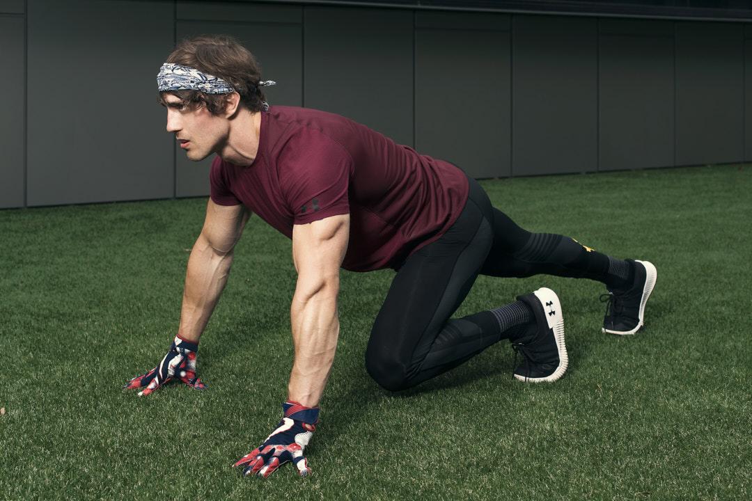Justin Melbourne NFL player doing push-ups