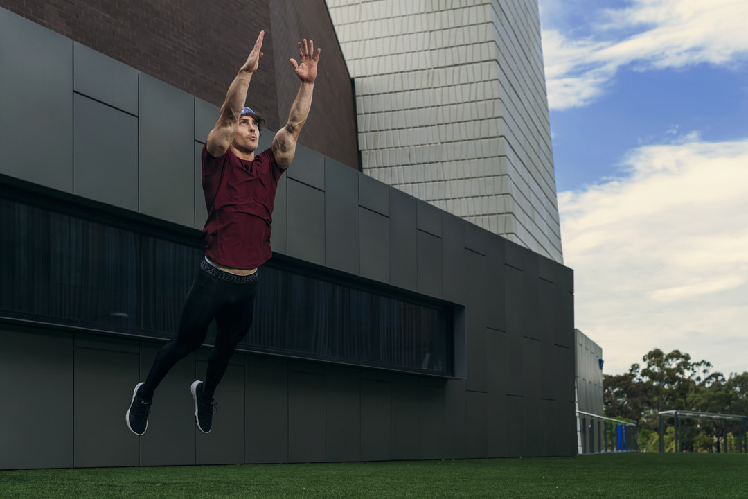 Justin leaping catching a NFL ball midair