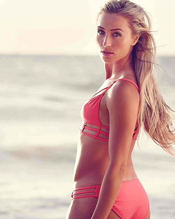 Justyna featuring in a pink two piece swimsuit
