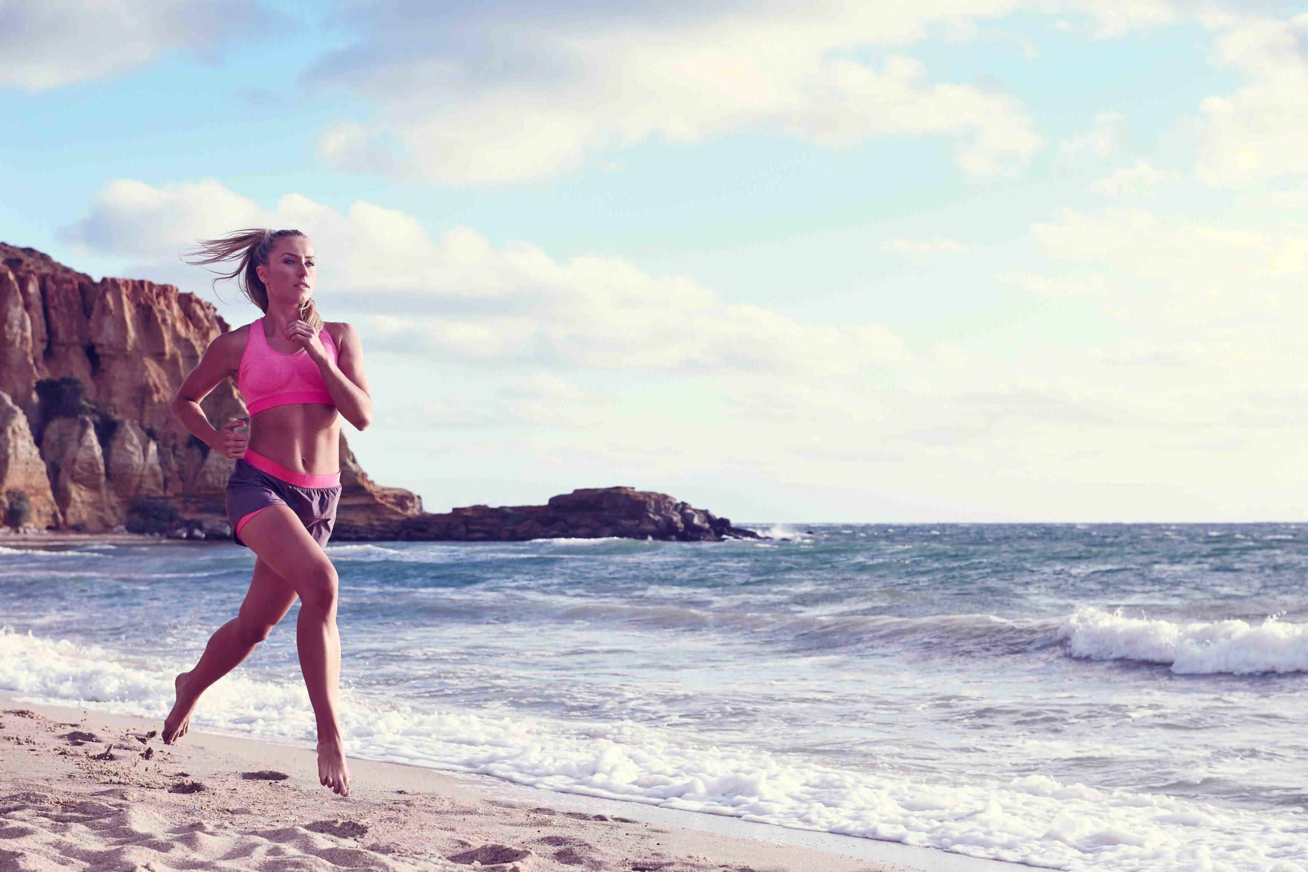 Justyna running along beach