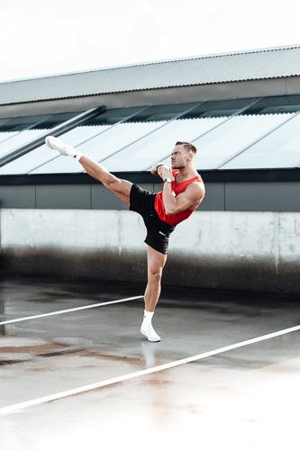 Kacper doing an overhead kick in car park