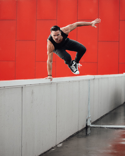 Kacper jumping over wall