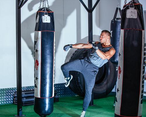 Kacper kicking along bag in gym