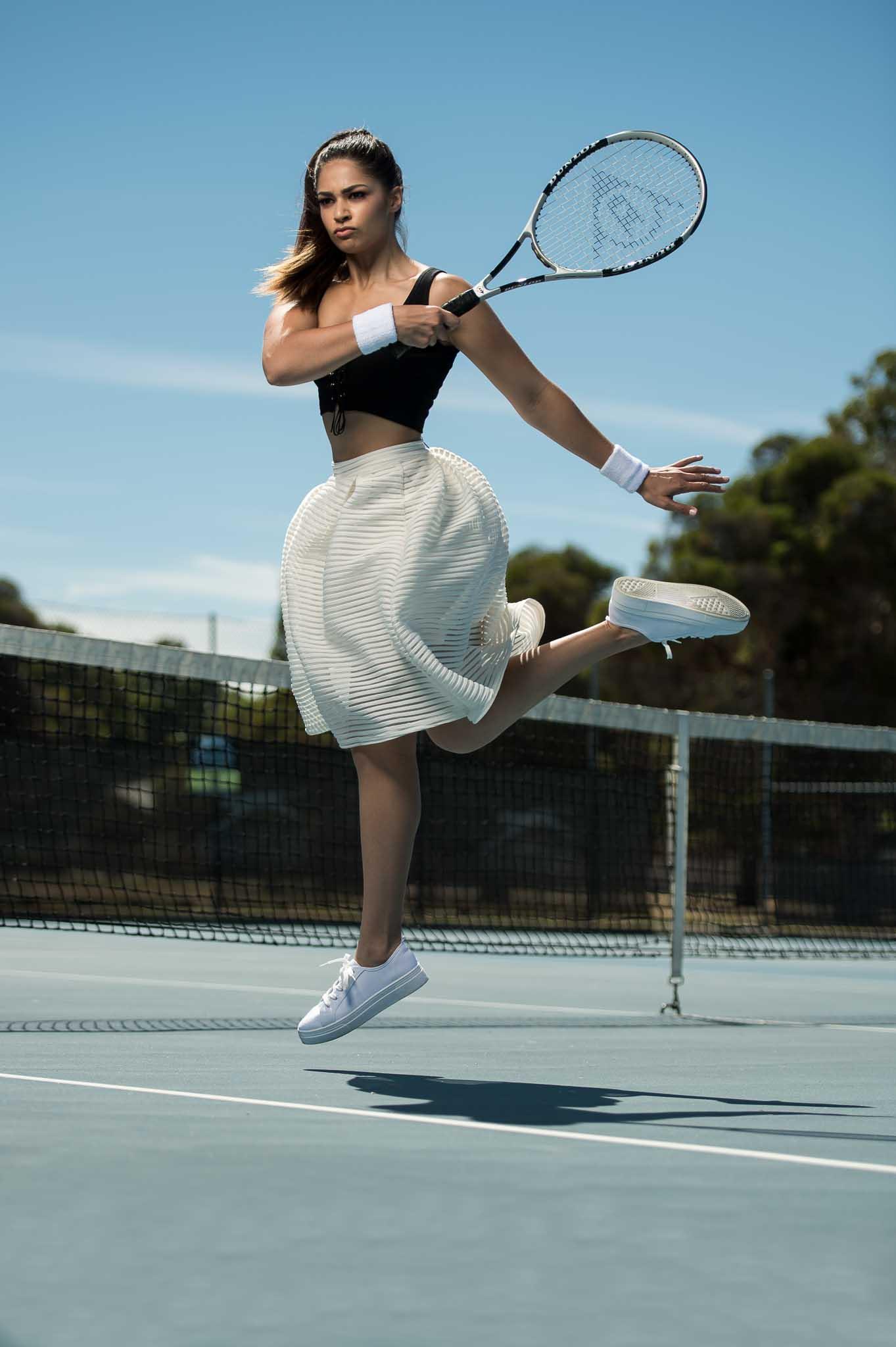 Karina Perths female fitness talent playing tennis
