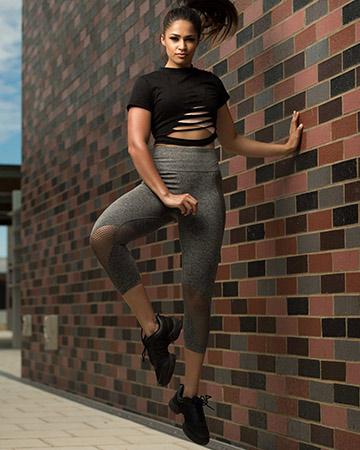 Karina jumping against wall wearing Lorna Jane's latest apparel